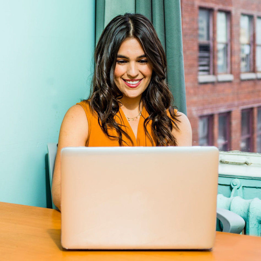 Smiling professional woman at laptop